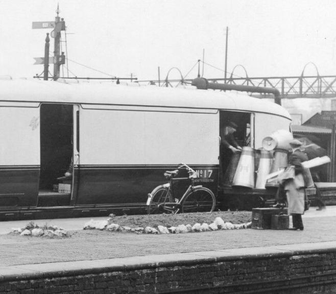 milk churns being loaded onto GWR Express Railcar 17